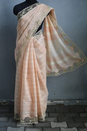 Peach organza cutwork saree with block print