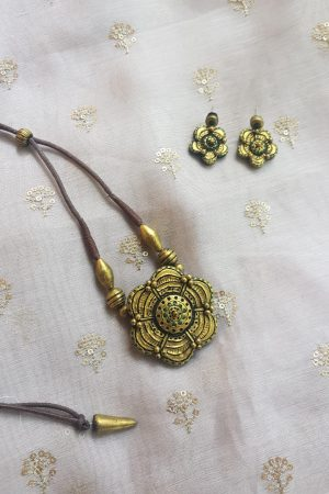 gold flower pendant terracotta