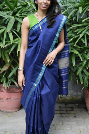 Navy kanchi silk saree turquoise thread border