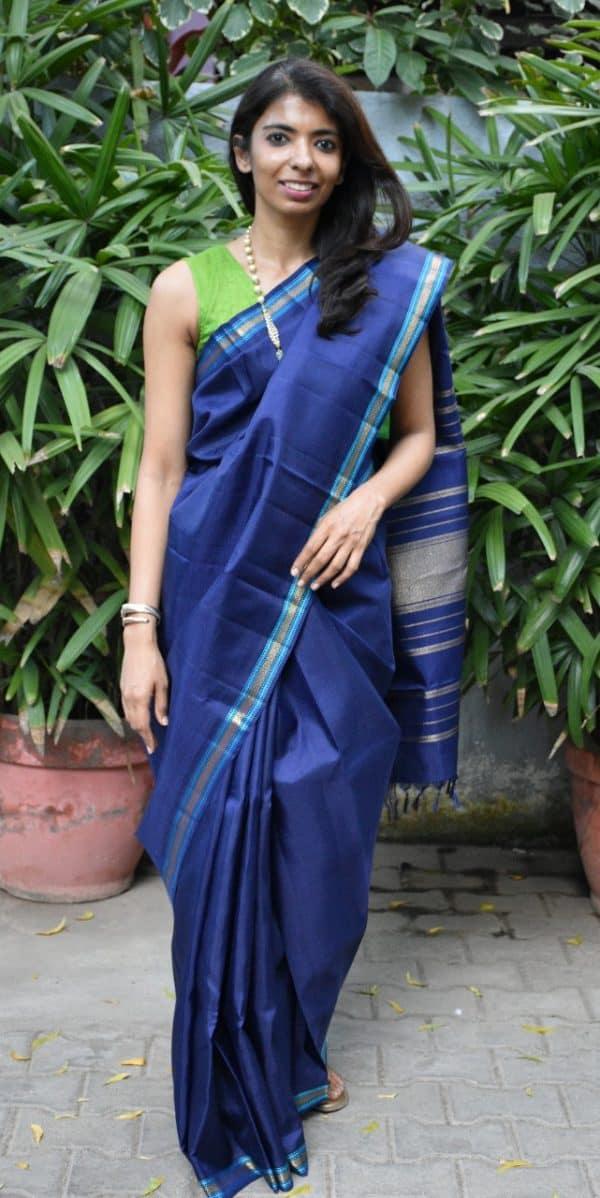 Navy kanchi silk saree turquoise thread border