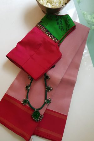 Plain dusty pink kanchi silk saree with korvai red pallu