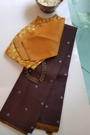 brown kancheepuram silk saree with silver buttis