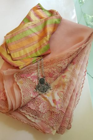 Dusty pink organza cutwork saree with printed pallu