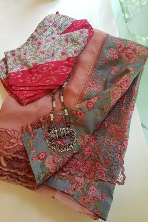 Pale Pink organza cutwork saree with printed pallu