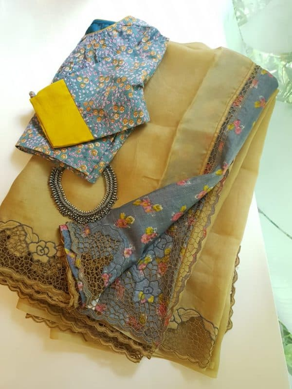 Pale yellow organza cutwork saree with printed pallu