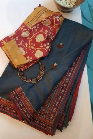 Grey hand embroidered tussar saree