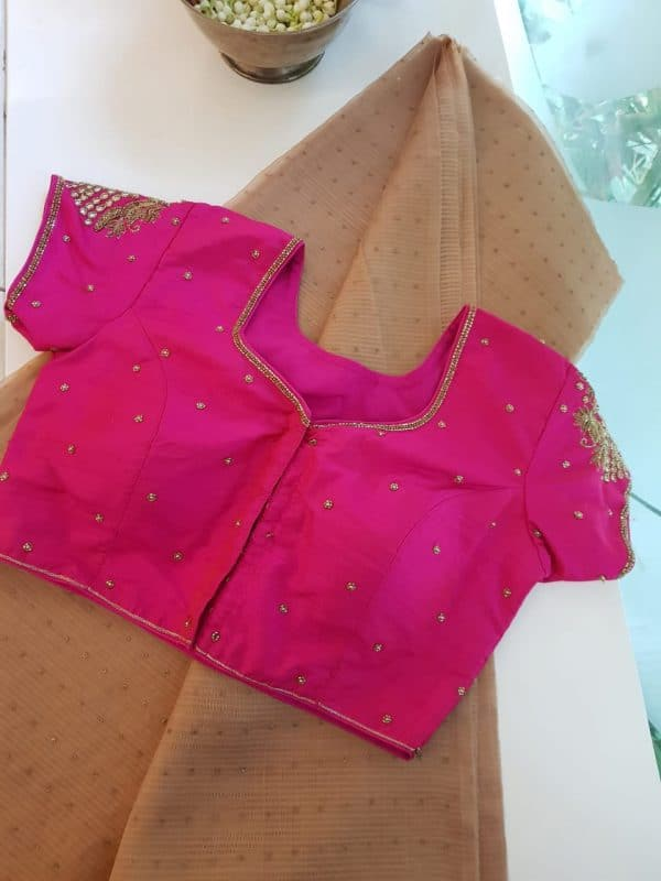 Bright pink raw silk blouse front