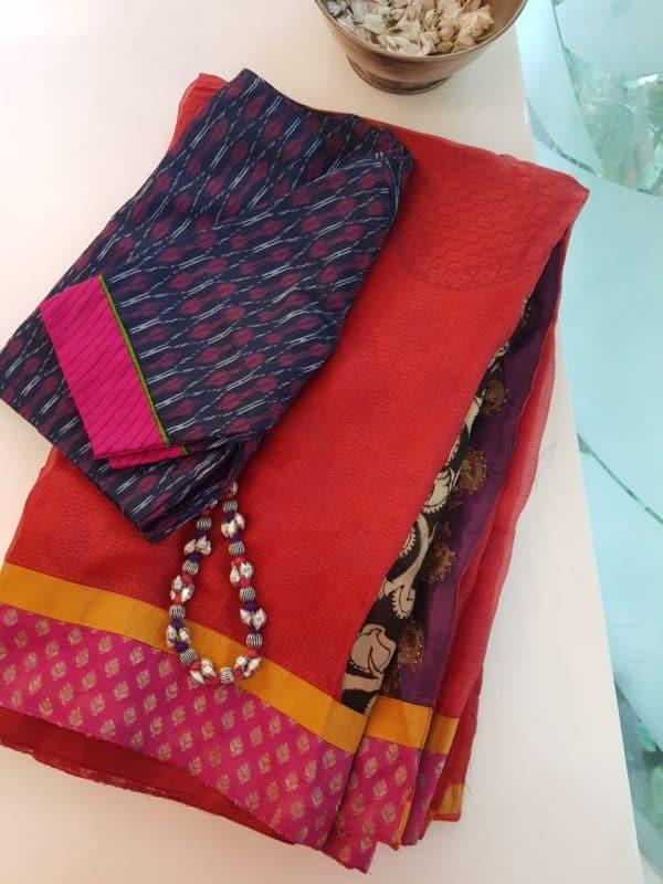 Orange silk kota saree with kalamkari pallu