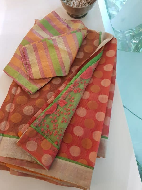 Peach and green net partly fusion saree
