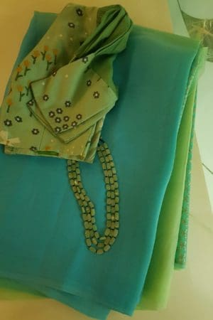 Teal green shaded organza saree
