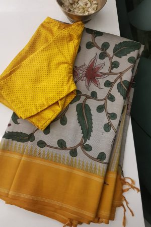 beige kalamkari silk saree with mustard korvai border