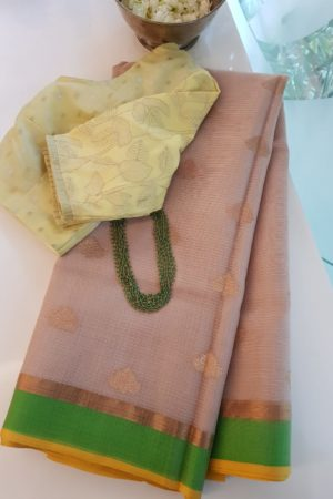 Beige real zari kota saree with green border