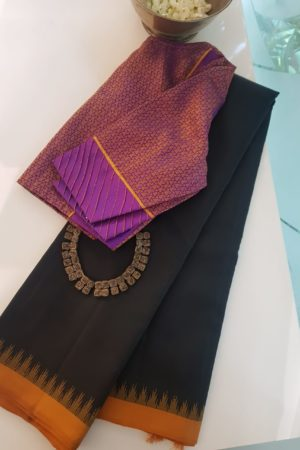 Black kanchi silk saree with mustard korvai border 1