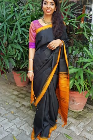 Black kanchi silk saree with mustard korvai border
