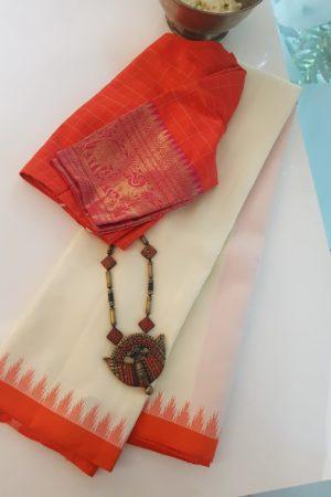 Cream kanchi silk saree with orange korvai border
