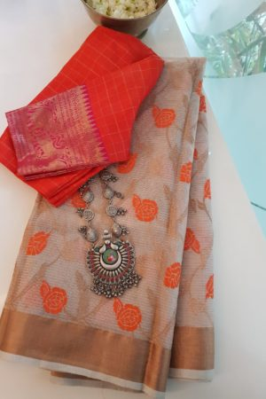 Cream real zari kota saree with orange flowers