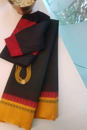 Dark green cotton saree with mustard silk border