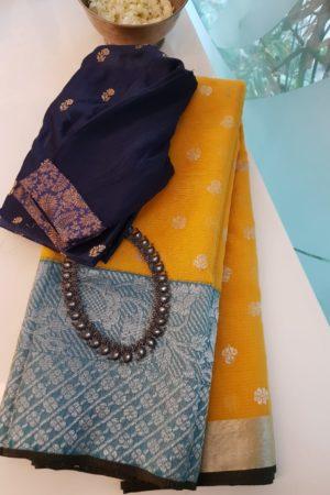 Golden yellow real zari kota saree with blue border