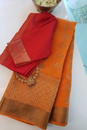 Orange one side long border real zari kota saree