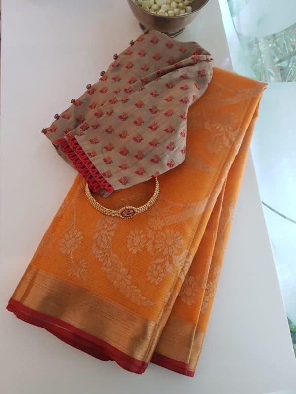 Orange ornate design real zari kota saree