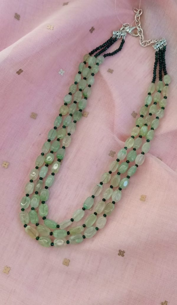 Pale green bead layers