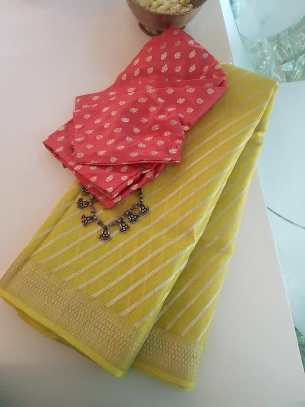 Pale yellow leheriya real zari kota saree