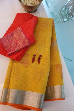 Pale yellow with orange border real zari kota saree