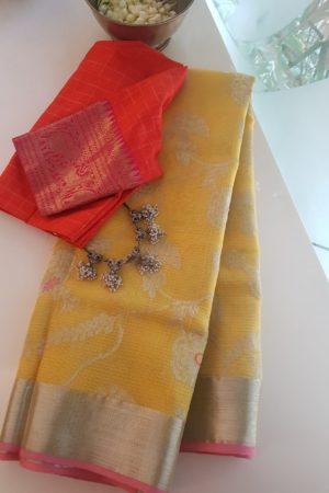 Pale yellow with pink border real zari kota saree
