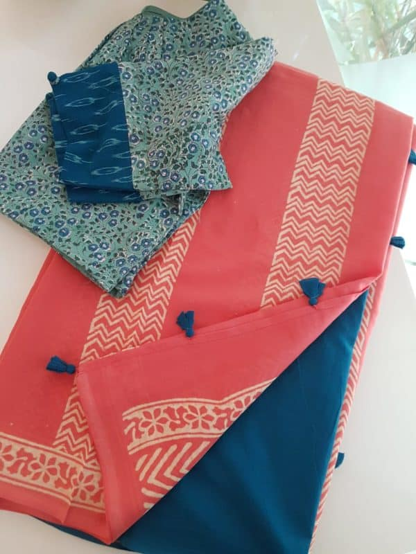 Peach mul saree with contrast blouse