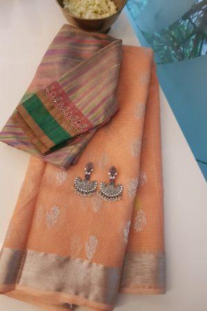 Peach with silver real zari kota saree