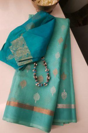 Sea green real zari kota saree with gold and silver buttis