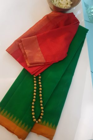 green kanchi silk saree with mustard korvai border