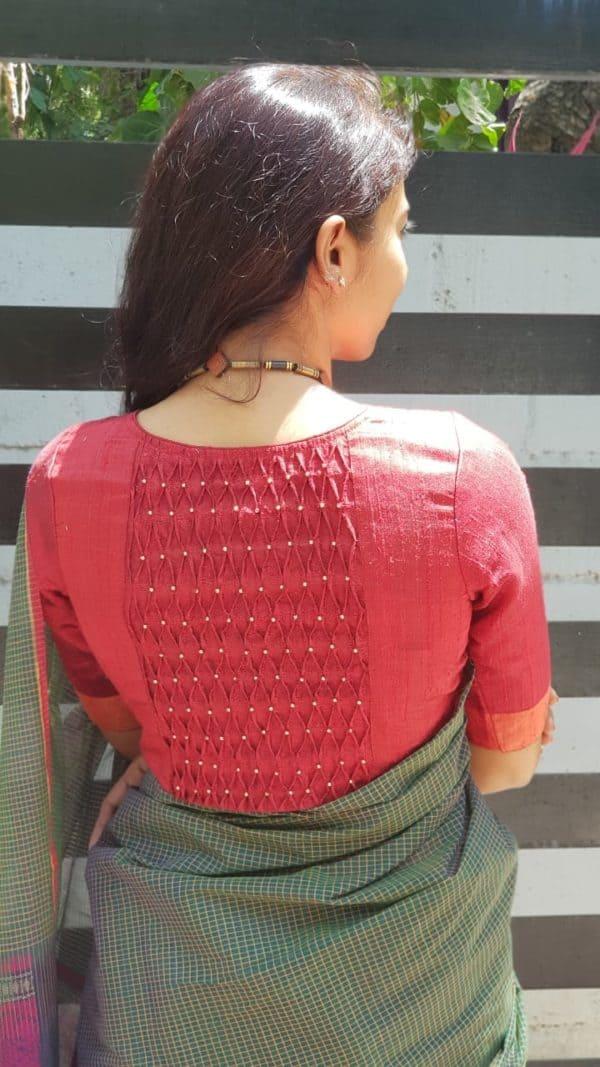 red smocked panel silk blouse