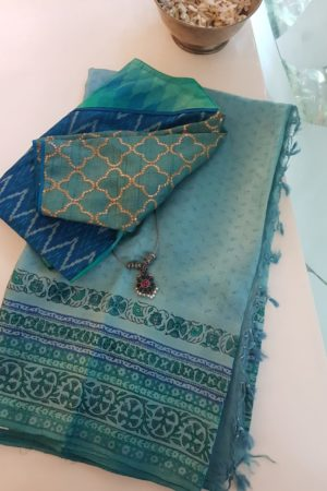 Pale blue tussar block printed saree