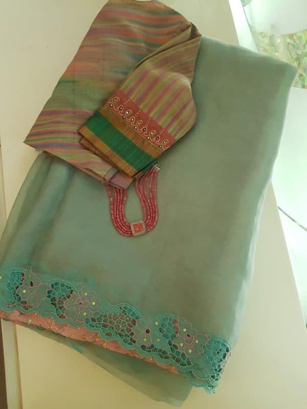 Pale sea green organza cutwork saree