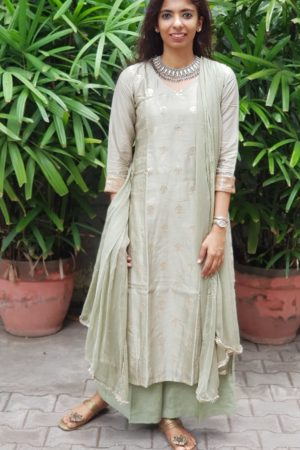 Pastel green embroidered chandheri suit