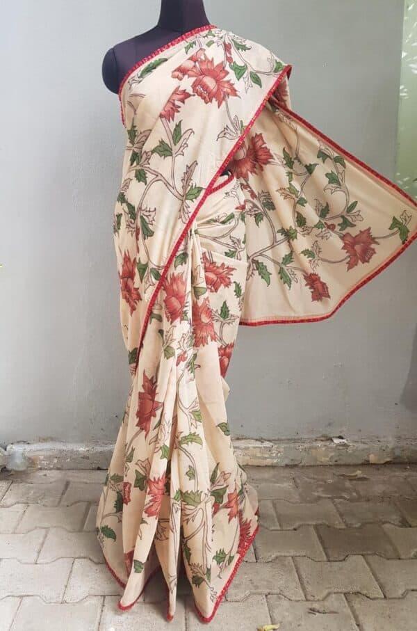 Beige chiffon kalamkari saree with red kanchipuram pleats border