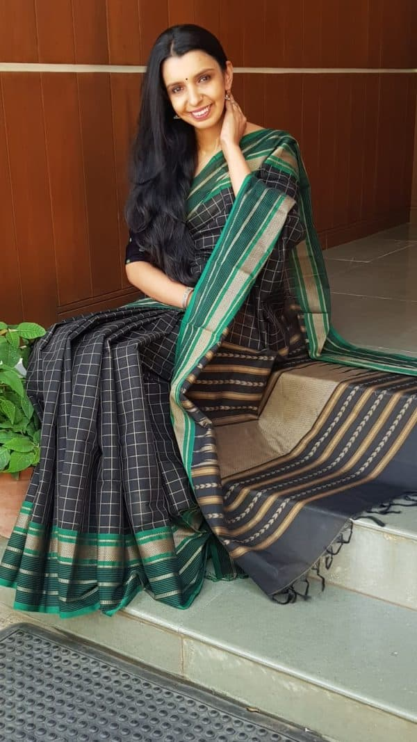 Black kanchi cotton saree with green border 1