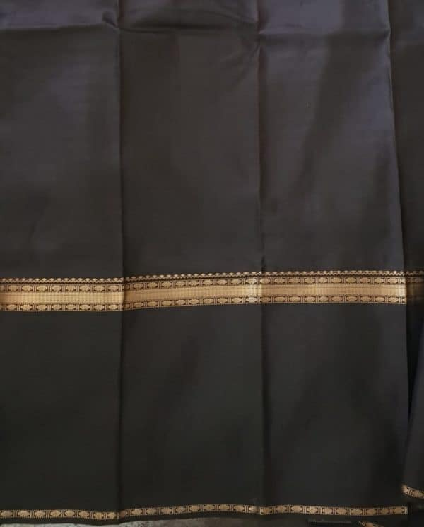 Black kanchipuram silk saree with horizontal lines blouse