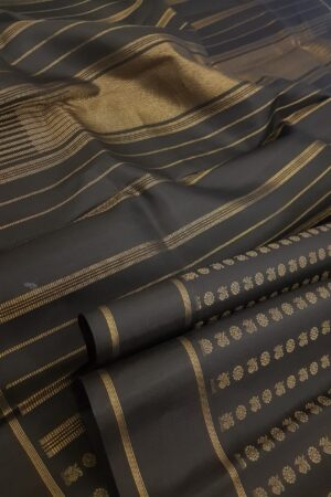 Black silk saree with mayil chakram motifs body