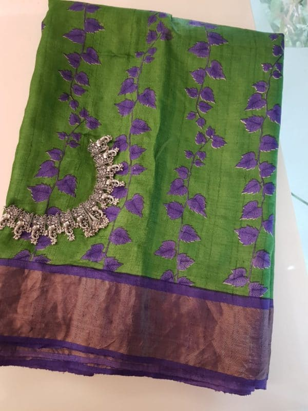 Green block printed tussar saree with zari border