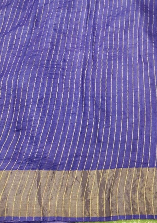 Green block printed tussar saree with zari border blouse