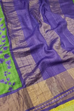 Green block printed tussar saree with zari border pallu