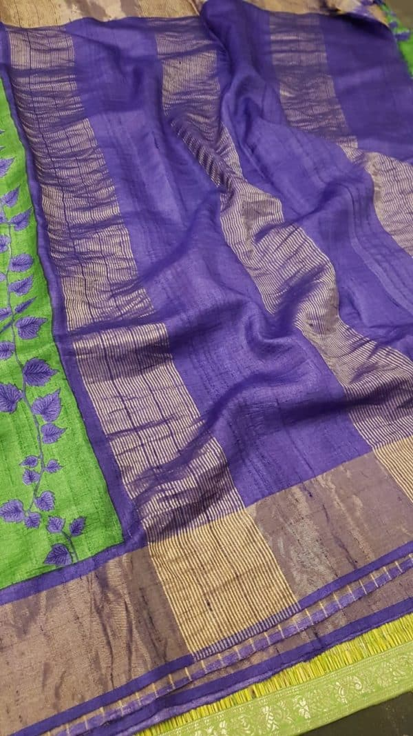Green block printed tussar saree with zari border pallu