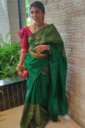 Green kanchipuram silk saree with contrast blouse 2