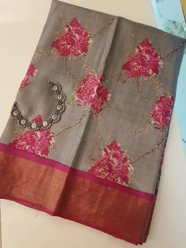 Grey tussar saree with oink tissue border and floral prints