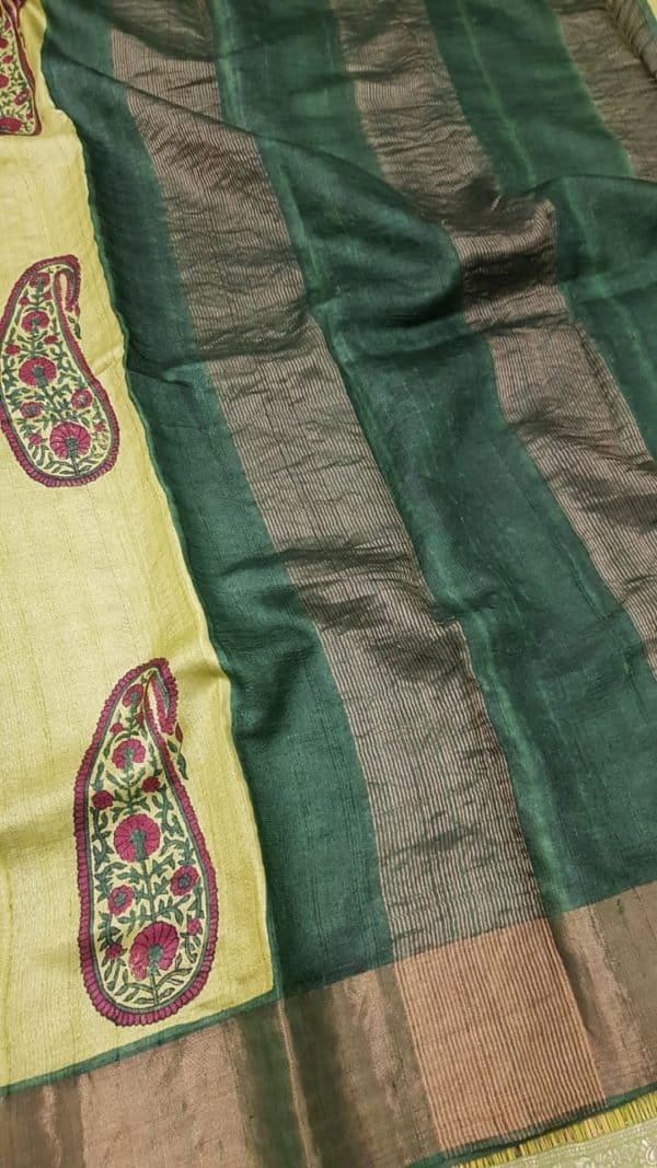 Light green block printed tussar saree with tissue border pallu