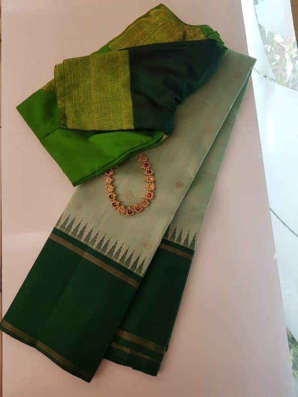 Light green with dark green korvai border silk saree