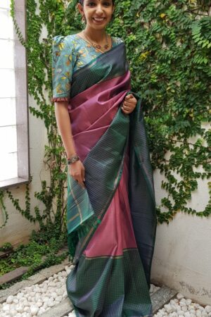 Onion pink kanchipuram silk saree with peacock green border
