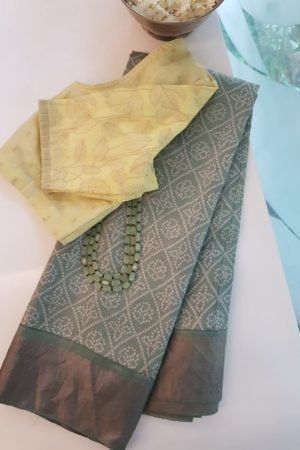 Pale green block printed tussar saree with tissue border